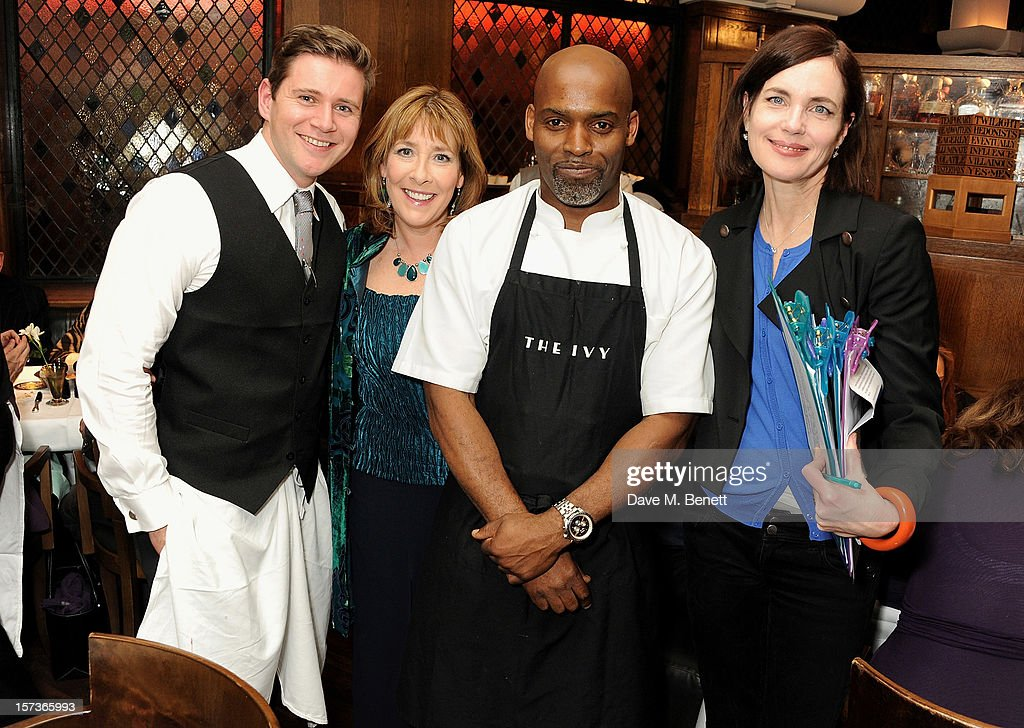 Actor Allen Leech, working as a waiter, Phyllis Logan, guest, and Elizabeth McGovern, working as Hostess, attend One Night Only at The Ivy, featuring 30 stage and screen actors working as staff during dinner at The Ivy, in aid of The Combined Theatrical Charities, on December 2, 2012 in London, England.