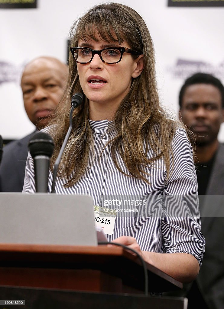 Actor Amanda Peet speaks during a news conference hosted by the Mayors Against Illegal Guns and the Law Center to Prevent Gun Violence with Rep. Elijah Cummings (D-MD) (L) and actor Chris Rock at the U.S. Capitol February 6, 2013 in Washington, DC. The artists, activists and politicians called for manditory background check on all gun purchases among other restrictions.