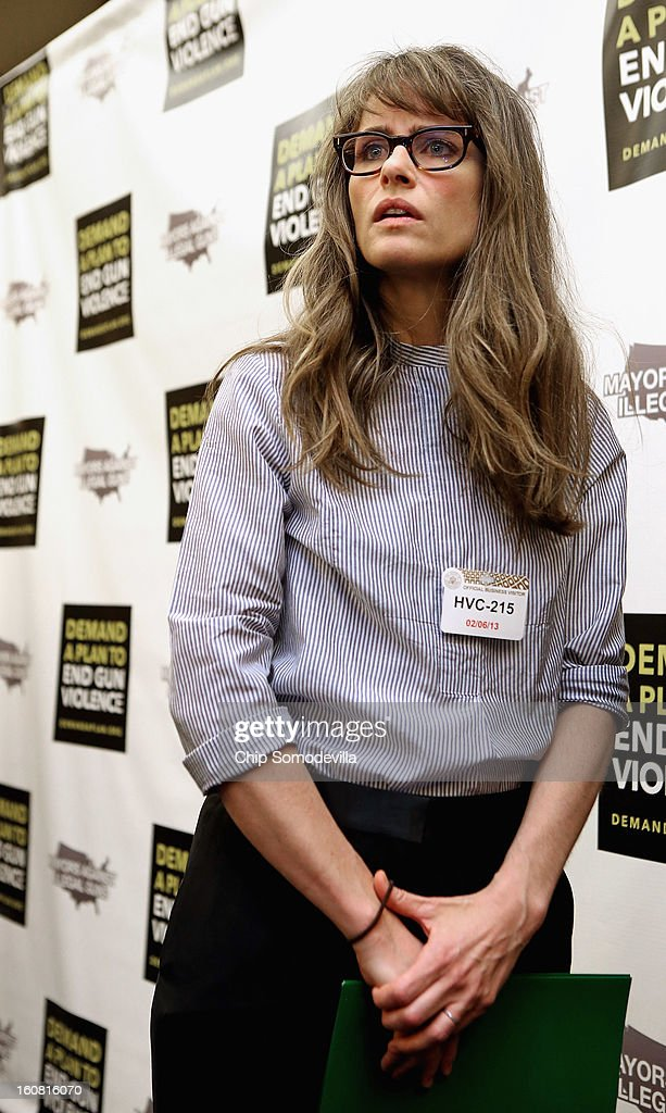 Actor <a gi-track='captionPersonalityLinkClicked' href=/galleries/search?phrase=Amanda+Peet&family=editorial&specificpeople=201910 ng-click='$event.stopPropagation()'>Amanda Peet</a> talks with journalists after participating in a news conference hosted by the Mayors Against Illegal Guns and the Law Center to Prevent Gun Violence at the U.S. Capitol February 6, 2013 in Washington, DC. The artists, activists and politicians called for manditory background check on all gun purchases among other restrictions.