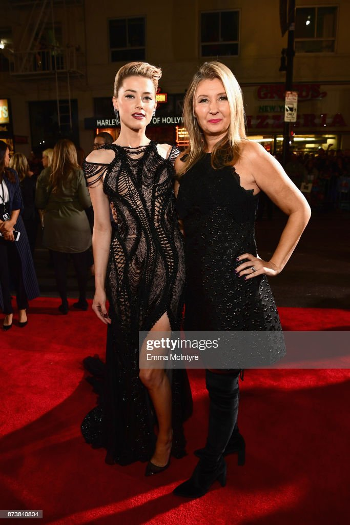 Actor Amber Heard and producer Deborah Snyder attend the premiere of Warner Bros. Pictures' 'Justice League' at Dolby Theatre on November 13, 2017 in Hollywood, California.