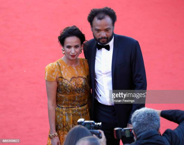 Actor Amelle Chahbi and Fabrice Eboue attend the 'Okja' premiere during the 70th annual Cannes Film Festival at Palais des Festivals on May 19 2017...