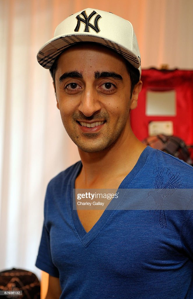 Actor Amir Talai poses with the New Era Cap display during the HBO Luxury Lounge in honor of the 60th annual Primetime Emmy Awards featuring the In Style diamond suite, held at the Four Seasons Hotel on September 21, 2008 in Beverly Hills, California.