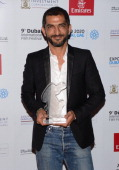 Actor Amr Waked with the Muhr Arab Feature Best Actor award during the Closing Ceremony on day eight of the 9th Annual Dubai International Film...