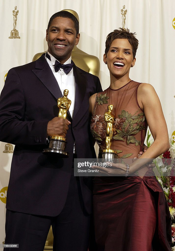 Actor and Actress in a Leading Role winners Denzel Washington and Halle Berry pose with their Oscars backstage