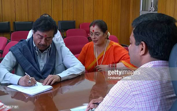 Actor and BJP candidate from Patna Sahib Lok Sabha seat Shatrughan Sinha accompanied by his wife Poonam Sinha filing his nomination papers on March...