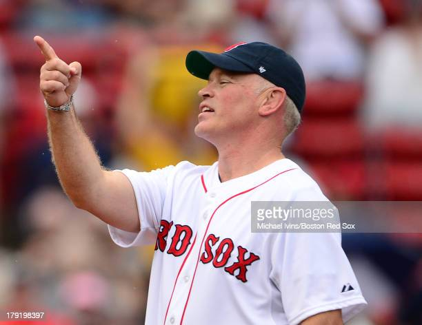 Actor and Cape Cod native Neil McDonough gestures to the crowd before throwing out a ceremonial first pitch at a game between the Boston Red Sox and...