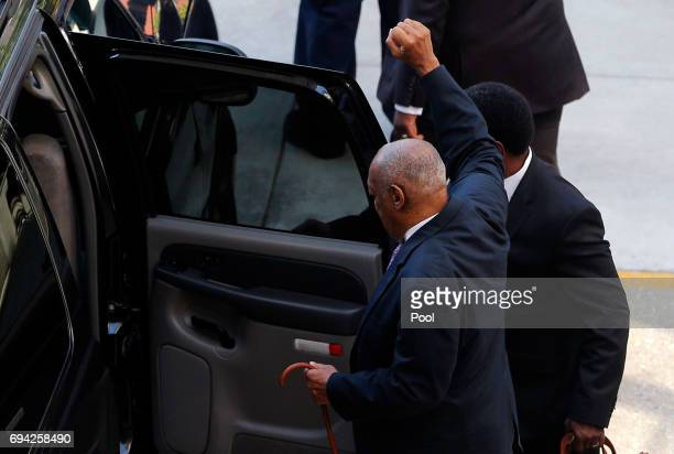 Actor and comedian Bill Cosby gestures to fans as he departs following the fifth day of Cosby's sexual assault trial at the Montgomery County...
