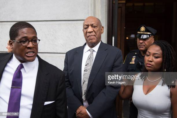 Actor and comedian Bill Cosby looks on as his publicist Andrew Wyatt addresses the media outside the Montgomery County Courthouse on June 17 2017 in...
