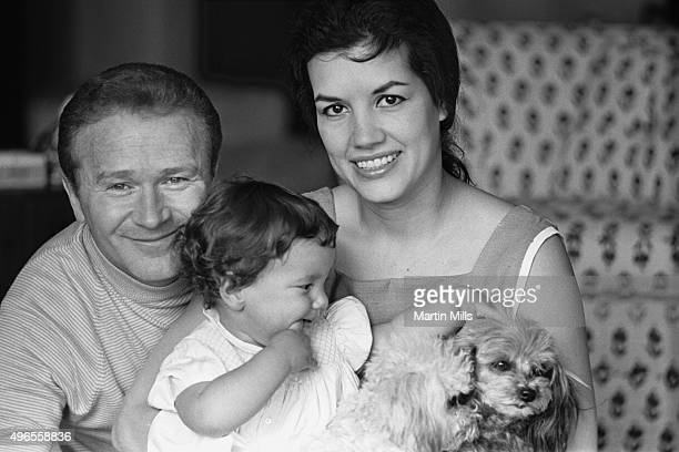 Actor and comedian Red Buttons with his wife Alicia Prats pose for a portrait with daughter Amy Buttons circa 1968 in Los Angeles California