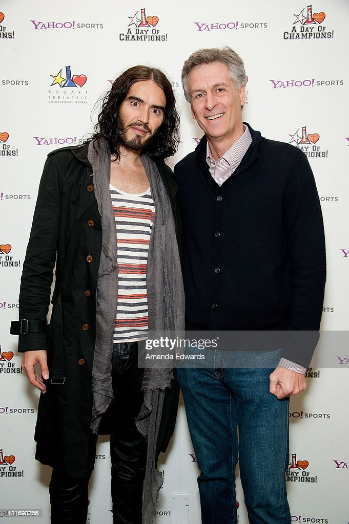 Actor and comedian <a gi-track='captionPersonalityLinkClicked' href=/galleries/search?phrase=Russell+Brand&family=editorial&specificpeople=536593 ng-click='$event.stopPropagation()'>Russell Brand</a> (L) Bogart Pediatric Cancer Research Program Chairman John Jameson attend the Yahoo! Sports Presents A Day Of Champions event at the Sports Museum of Los Angeles on November 6, 2011 in Los Angeles, California.