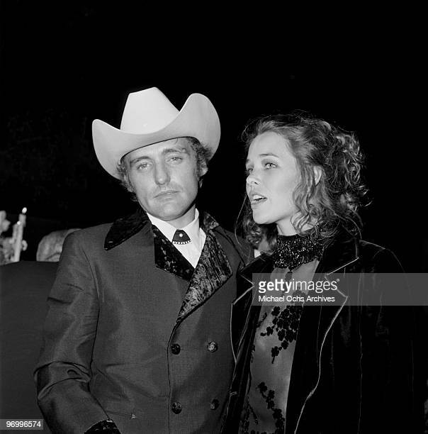 Actor and director Dennis Hopper and actress and singer Michelle Phillips attend the Governor's Ball after the 42nd Acadamy Awards on April 7 1970 in...