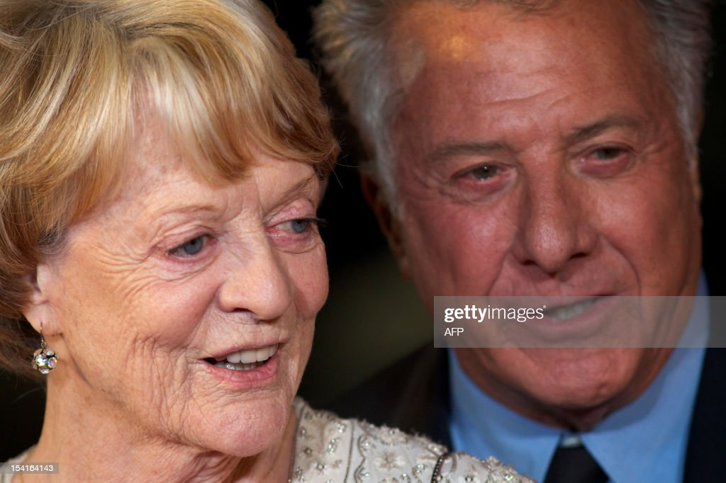 US actor and director Dustin Hoffman (R) poses with British actress Maggie Smith (L) on the red carpet as they arrive to attend the premiere of 'Quartet' during the 56th BFI London Film Festival in London on October 15, 2012. Quartet, directed by Dustin Hoffman stars Maggie Smith, Michael Gambon and Scottish comedian Billy Connolly.