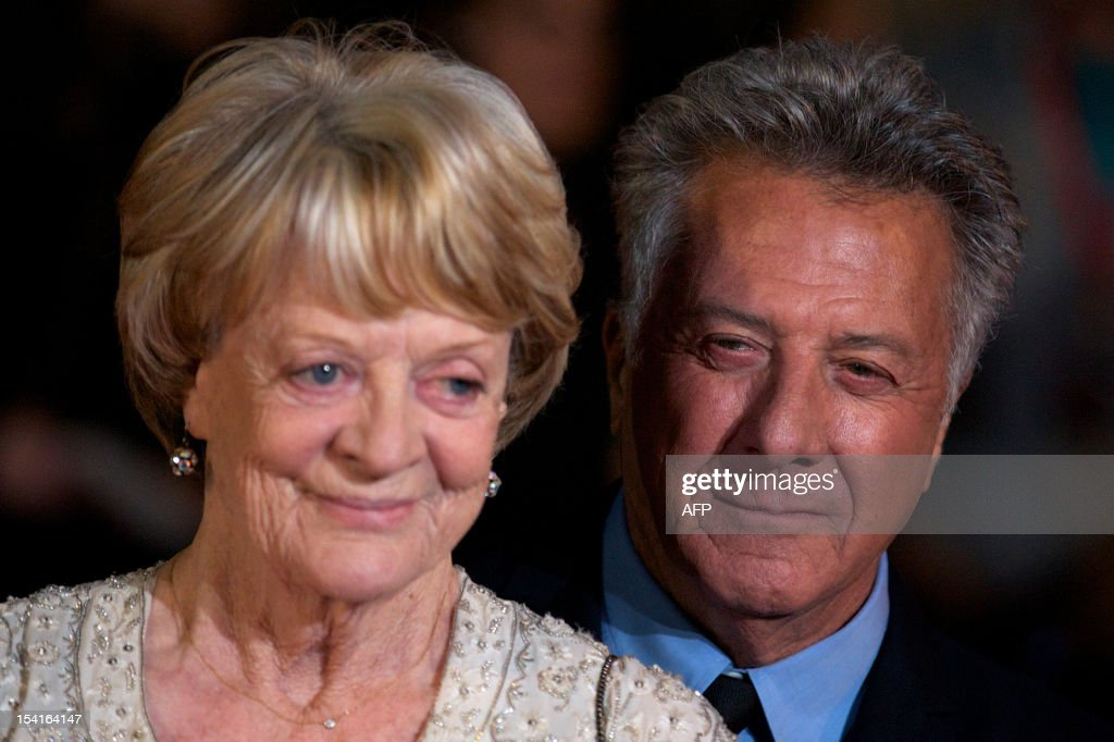 US actor and director Dustin Hoffman (R) poses with British actress Maggie Smith (L) on the red carpet as they arrive to attend the premiere of 'Quartet' during the 56th BFI London Film Festival in London on October 15, 2012. Quartet, directed by Dustin Hoffman stars Maggie Smith, Michael Gambon and Scottish comedian Billy Connolly. AFP PHOTO / ANDREW COWIE