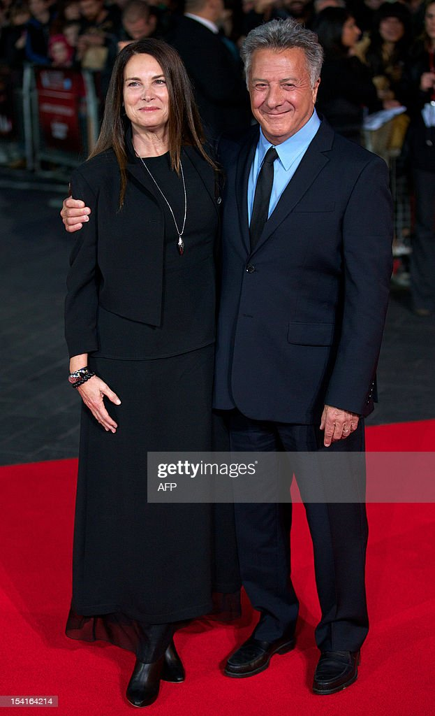 US actor and director Dustin Hoffman (R) poses with his wife Lisa Hoffman on the red carpet as they arrive to attend the premiere of 'Quartet' during the 56th BFI London Film Festival in London on October 15, 2012. Quartet, directed by Dustin Hoffman stars Maggie Smith, Michael Gambon and Scottish comedian Billy Connolly.