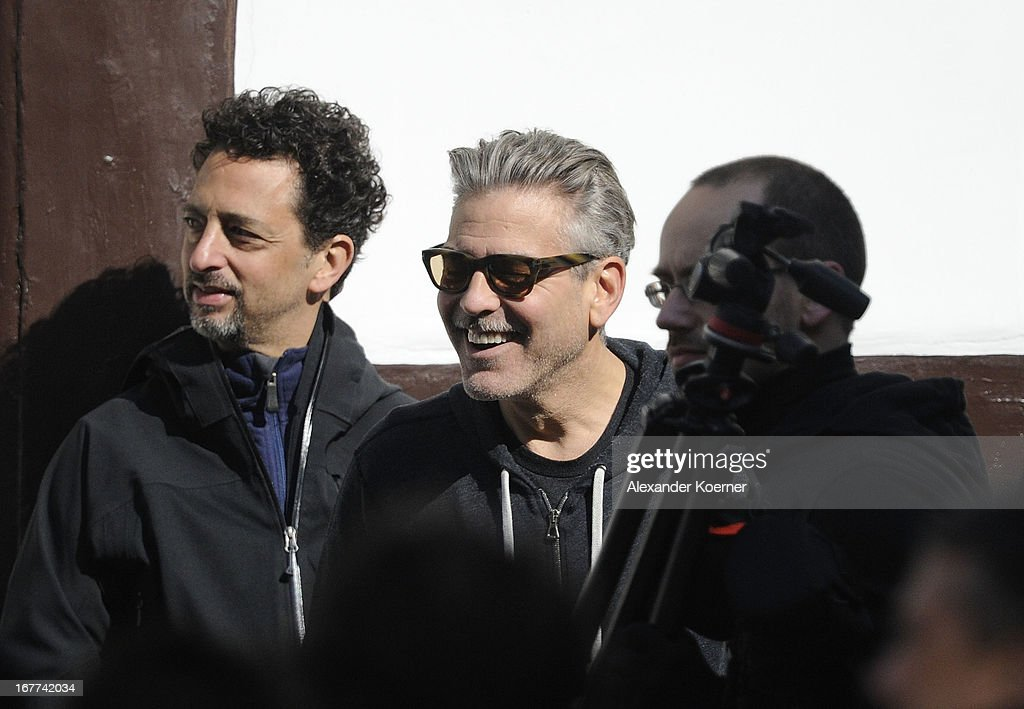 Actor and director <a gi-track='captionPersonalityLinkClicked' href=/galleries/search?phrase=George+Clooney&family=editorial&specificpeople=202529 ng-click='$event.stopPropagation()'>George Clooney</a> and <a gi-track='captionPersonalityLinkClicked' href=/galleries/search?phrase=Grant+Heslov&family=editorial&specificpeople=607201 ng-click='$event.stopPropagation()'>Grant Heslov</a> are seen on set of his current project 'The Monuments Men' on April 29, 2013 in Goslar, Germany. The film features several locations in the state of Lower Saxony and around Germany.