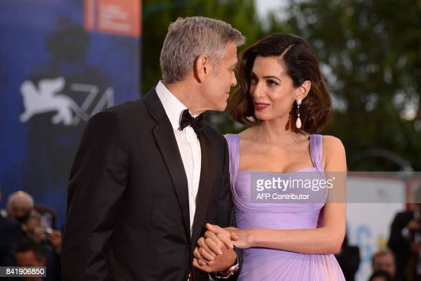US actor and director George Clooney and his wife Amal attend the premiere of the movie 'Suburbicon' presented out of competition at the 74th Venice...