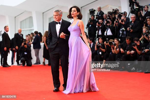 TOPSHOT US actor and director George Clooney and his wife Amal attend the premiere of the movie 'Suburbicon' presented out of competition at the 74th...