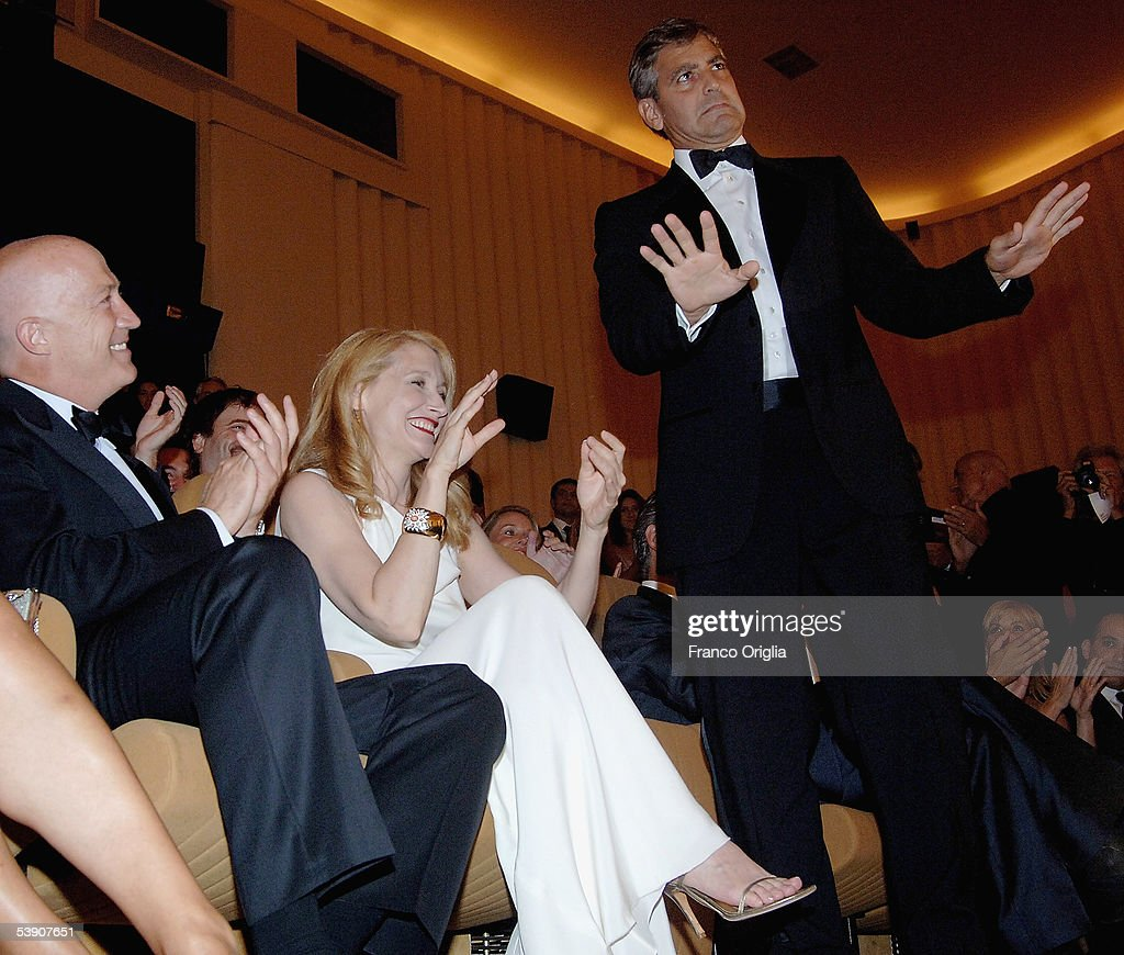 Actor and Director George Clooney (R) is applauded by actress and co-star Patricia Clarkson inside the auditorium at the premiere for his new film 'Good Night, And Good Luck' at the Palazzo del Cinema as part of the 62nd Venice Film Festival on September 1, 2005 in Venice, Italy.