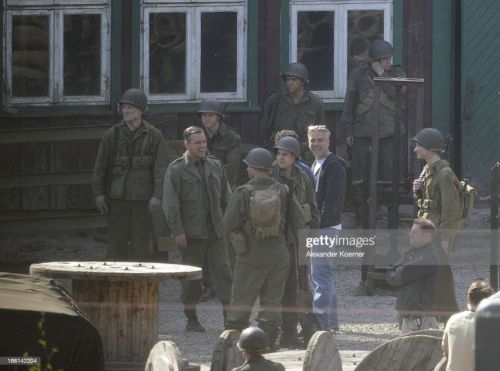Actor and director George Clooney is seen cheering together with Matt Damon on George Clooney's 51st birthday at the set of the film 'The Monuments Men' on May 06, 2013 in Bad Grund, Germany.