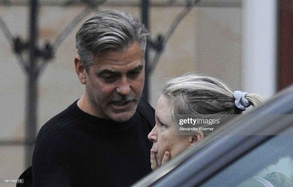Actor and director <a gi-track='captionPersonalityLinkClicked' href=/galleries/search?phrase=George+Clooney&family=editorial&specificpeople=202529 ng-click='$event.stopPropagation()'>George Clooney</a> is seen entering his hotel through the backdoor on April 28, 2013 in Ilsenburg, Germany. Clooney will shoot his current project 'The Monuments Men' on April 29, 2013 in the city of Goslar, Germany.
