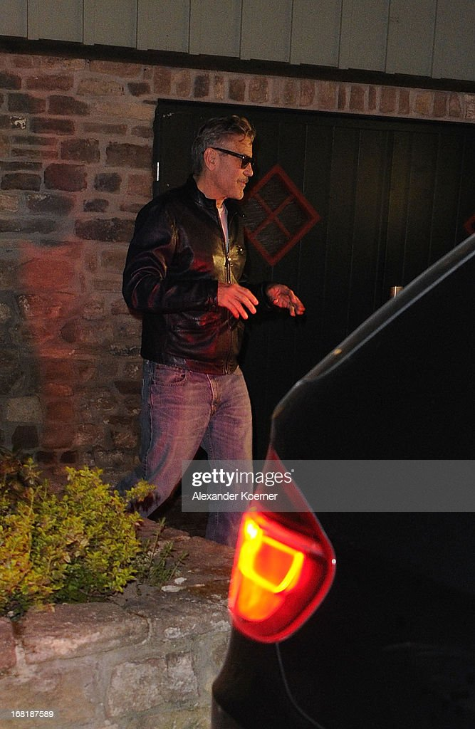 Actor and director <a gi-track='captionPersonalityLinkClicked' href=/galleries/search?phrase=George+Clooney&family=editorial&specificpeople=202529 ng-click='$event.stopPropagation()'>George Clooney</a> is seen leaving a restaurant on May 06, 2013 in Wernigerode, Germany. He celebrated his 52nd birthday together with Bill Murray and Matt Damon. Clooney currently shoots his film 'The Monuments Men' on several locations in the state of Lower Saxony and around Germany.