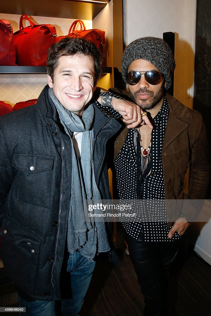 Actor and Director Guillaume Canet and singer Lenny Kravitz attend the Longchamp Elysees 'Lights On Party' Boutique Launch on December 4, 2014 in Paris, France.