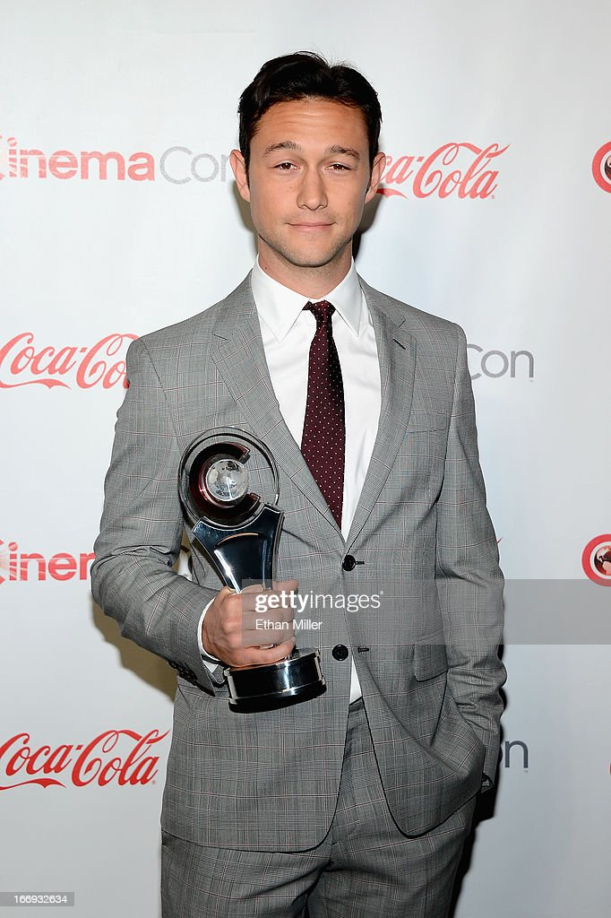 Actor and director <a gi-track='captionPersonalityLinkClicked' href=/galleries/search?phrase=Joseph+Gordon-Levitt&family=editorial&specificpeople=213632 ng-click='$event.stopPropagation()'>Joseph Gordon-Levitt</a>, recipient of the Breakthrough Filmmaker of the Year Award arrives at the CinemaCon awards ceremony at the Pure Nightclub at Caesars Palace during CinemaCon, the official convention of the National Association of Theatre Owners, on April 18, 2013 in Las Vegas, Nevada.