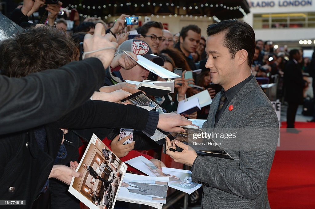 Actor and director <a gi-track='captionPersonalityLinkClicked' href=/galleries/search?phrase=Joseph+Gordon-Levitt&family=editorial&specificpeople=213632 ng-click='$event.stopPropagation()'>Joseph Gordon-Levitt</a> signs autographs as he attends the screening of 'Don Jon' during the 57th BFI London Film Festival at Odeon West End on October 16, 2013 in London, England.