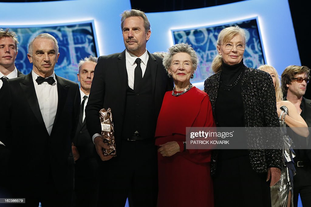 US actor and director Kevin Costner, French actress Emmanuelle Riva and Hungarian-born French producer Margaret Menegoz pose with their trophies beside French producer and President of the French film awards Cesars academy, Alain Terzian (L) at the end of the 38th Cesar Awards ceremony on February 22, 2013 at the Chatelet theatre in Paris.