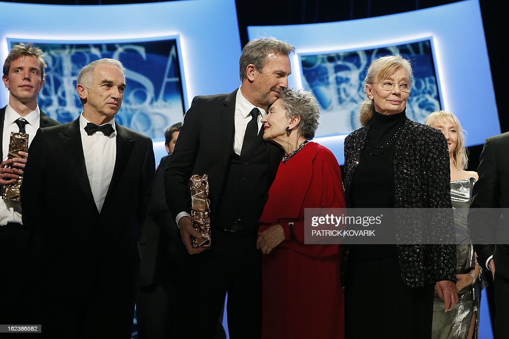 US actor and director Kevin Costner, French actress Emmanuelle Riva and Hungarian-born French producer Margaret Menegoz pose with their trophies beside French producer and President of the French film awards Cesars academy, Alain Terzian (L) at the end of the 38th Cesar Awards ceremony on February 22, 2013 at the Chatelet theatre in Paris. AFP PHOTO / PATRICK KOVARIK
