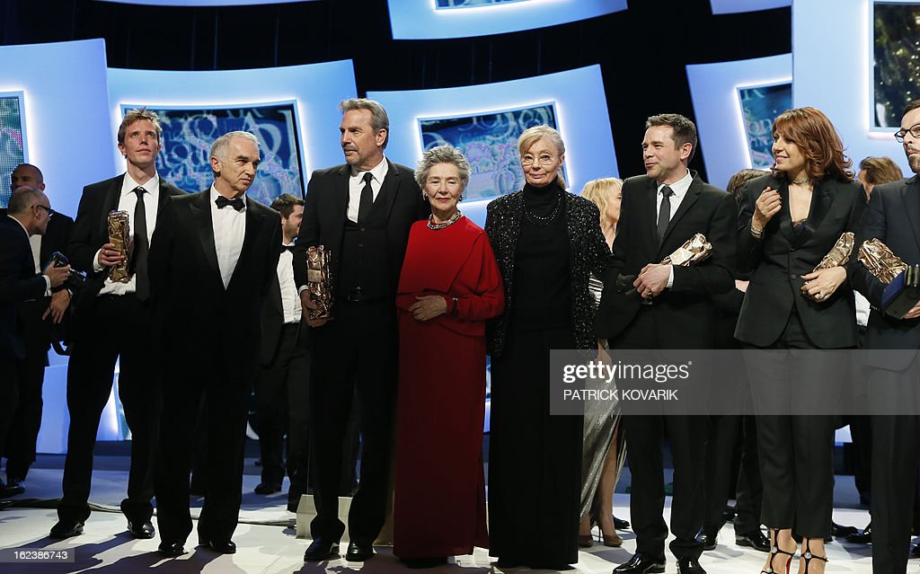 US actor and director Kevin Costner (3rd L) poses between French producer and President of the French film awards Cesars academy, Alain Terzian (2nd L) and French actress Emmanuelle Riva (4th L), beside (from R) French actress Valerie Benguigui, French actor Guillaume de Tonquedec and Hungarian-born French producer Margaret Menegoz at the end of the 38th Cesar Awards ceremony on February 22, 2013 at the Chatelet theatre in Paris. AFP PHOTO / PATRICK KOVARIK