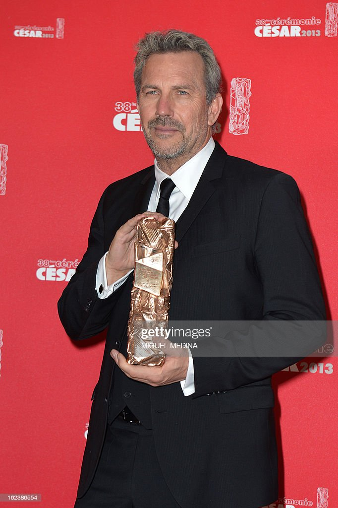 US actor and director Kevin Costner poses with his trophy after receiving a lifetime achievement award during a photocall at the 38th Cesar Awards ceremony on February 22, 2013 at the Chatelet theatre in Paris. AFP PHOTO / MIGUEL MEDINA