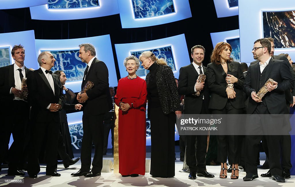 US actor and director Kevin Costner (3rd L) talks to French producer and President of the French film awards Cesars academy, Alain Terzian (2nd L) while French actress Emmanuelle Riva (C) listens to Hungarian-born French producer Margaret Menegoz (C,R) beside (from R) French director Cyril Mennegun, French actress Valerie Benguigui and French actor Guillaume de Tonquedec at the end of the 38th Cesar Awards ceremony on February 22, 2013 at the Chatelet theatre in Paris. AFP PHOTO / PATRICK KOVARIK
