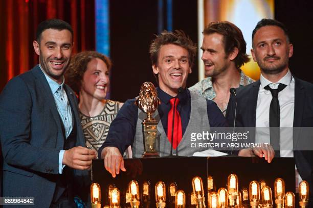 Actor and director Marc Pistolesi smiles surrounded by members of the cast after they won a Moliere award in the category 'spectacle musical' at the...