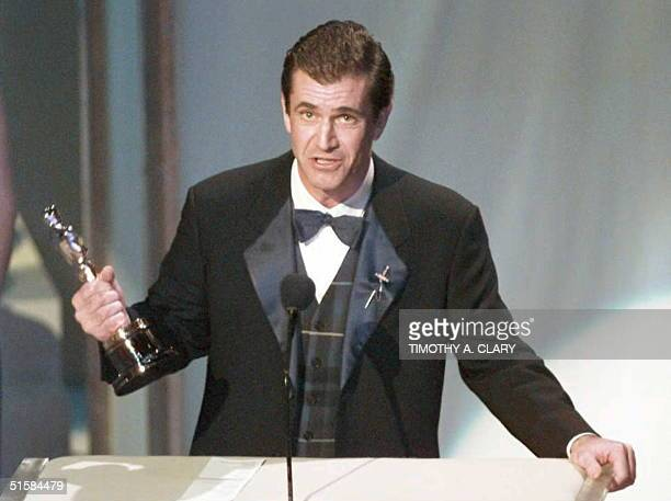 Actor and director Mel Gibson holds up his Oscar for Best Director for his film 'Braveheart' at the 68th Academy Awards March 25 1996 at the Dorothy...
