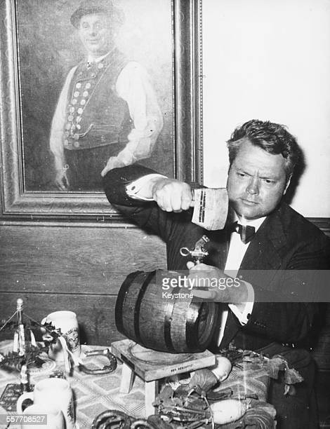 Actor and director Orson Welles tapping a beer keg at Platzl Munich May 4th 1954