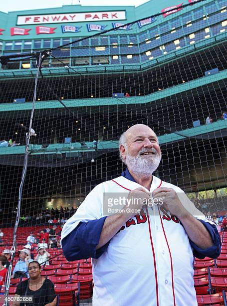 Actor and Director Rob Reiner is pictured as he buttons up his Red Sox jersey that he will wear when he throws out a ceremonial first pitch on June...