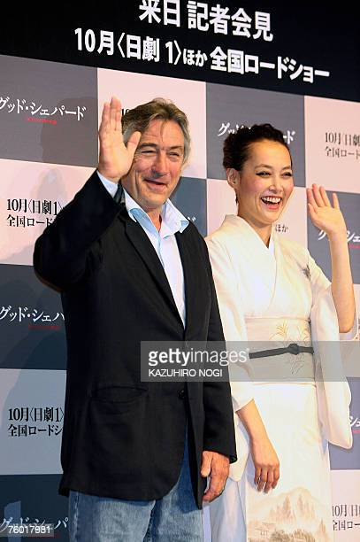 US actor and director Robert De Niro and Japanese guest Rinko Kikuchi wave to the press during a photo session after a news conference to promote his...