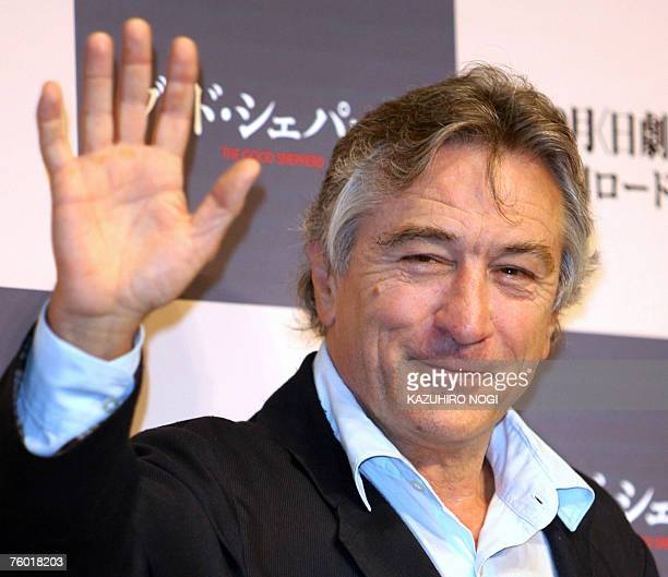 US actor and director Robert De Niro waves to photographers during a photo session at a news conference to promote his film 'The Good Shepherd ' in...