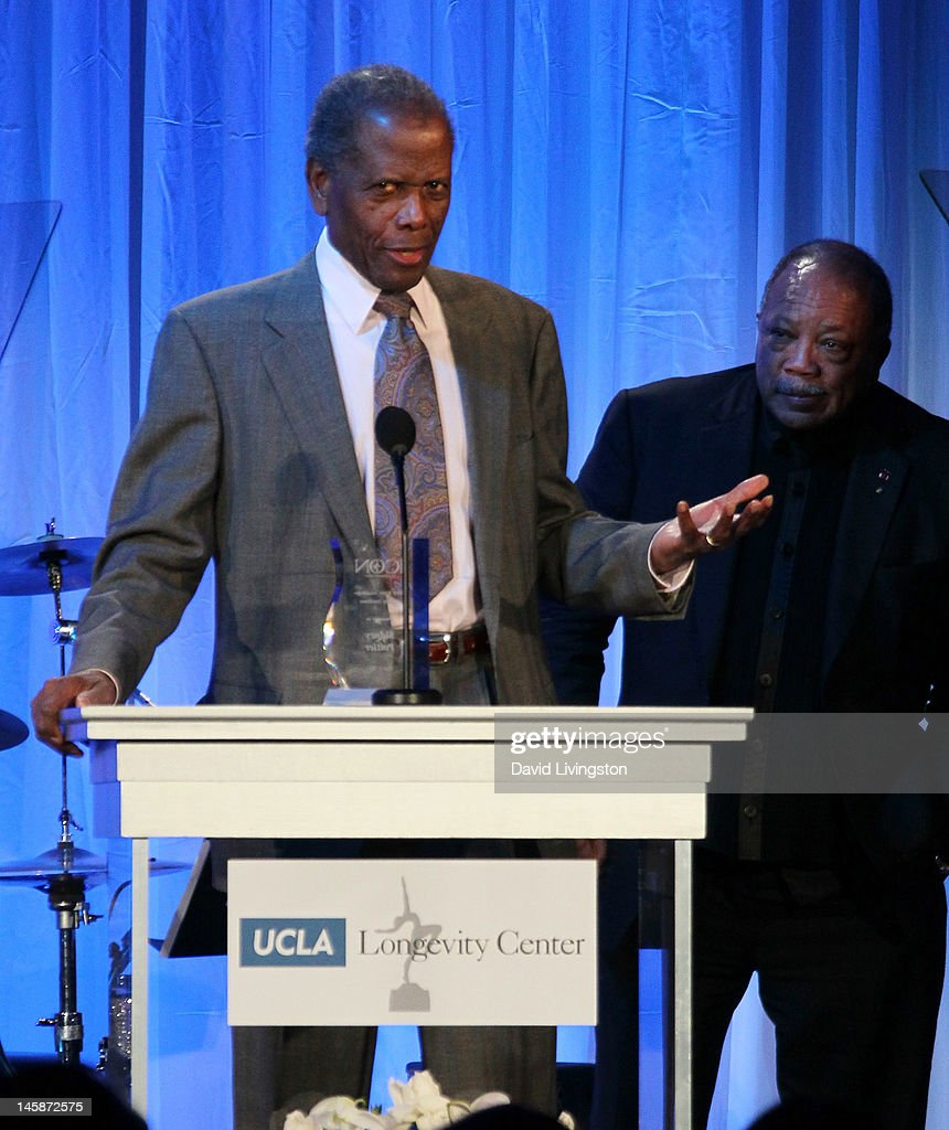 Actor and evening honoree <a gi-track='captionPersonalityLinkClicked' href=/galleries/search?phrase=Sidney+Poitier&family=editorial&specificpeople=94086 ng-click='$event.stopPropagation()'>Sidney Poitier</a> (L) and recording artist <a gi-track='captionPersonalityLinkClicked' href=/galleries/search?phrase=Quincy+Jones&family=editorial&specificpeople=171797 ng-click='$event.stopPropagation()'>Quincy Jones</a> appear on stage at the UCLA Longevity Center's 2012 ICON Awards at the Beverly Hills Hotel on June 6, 2012 in Beverly Hills, California.