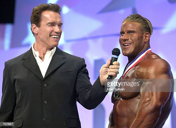Actor and former bodybuilder Arnold Schwarzenegger talks with Jay Cutler winner of The Arnold Classic 2002 February 23 2002 in Columbus OH