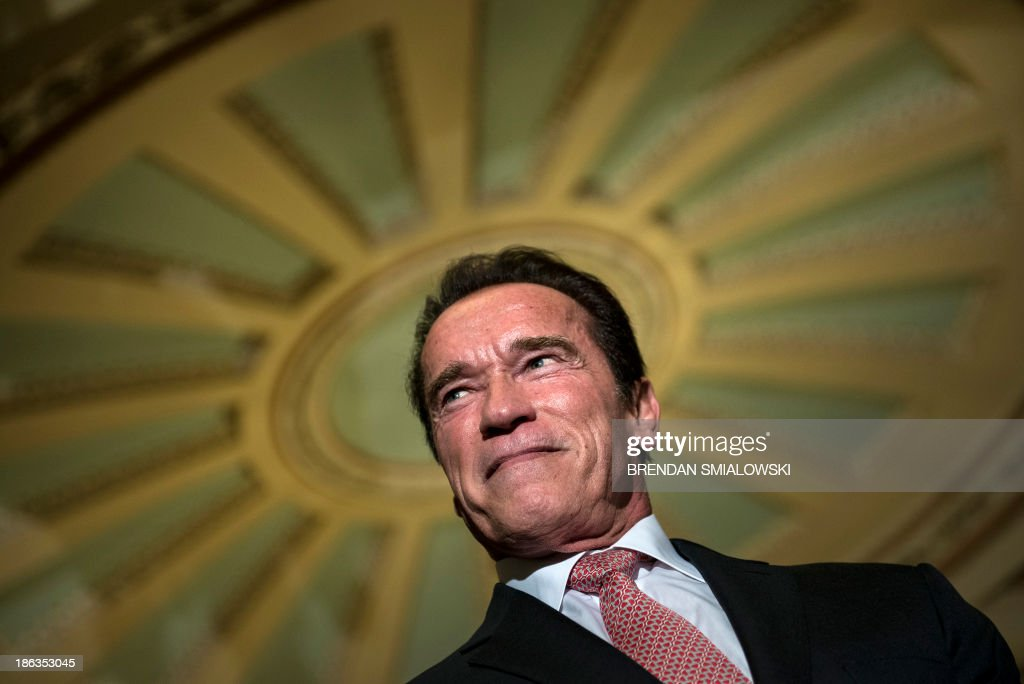 Actor and former California governor Arnold Schwarzenegger listens to questions from the press on Capitol Hill October 30 2013 in Washington DC...