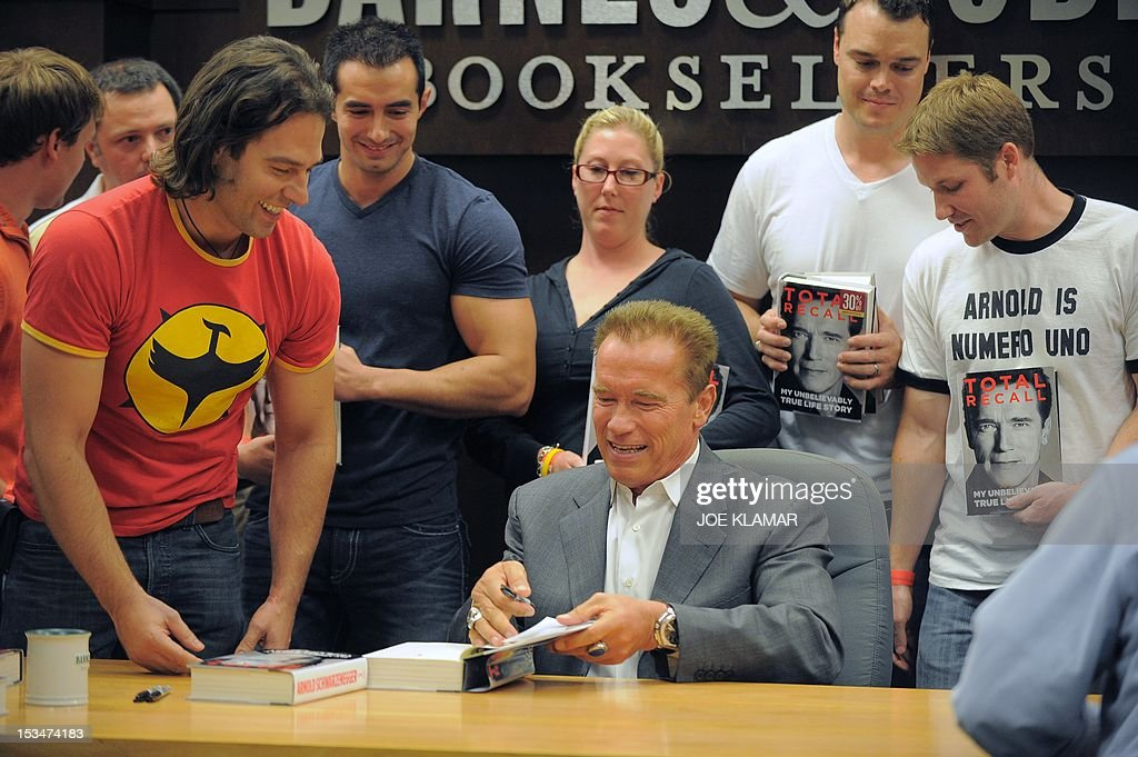 Actor and former California Governor Arnold Schwarzenegger meets fans as he signs his memoir, 'Total Recall - My Unbelievably True Life Story', October 5, 2012 in Los Angeles, California. Schwarzenegger's book, 'Total Recall', named after one of his blockbuster movies, includes details of his marital infidelities, including fathering a child with his housekeeper, leading his wife Maria Shriver to file for divorce.