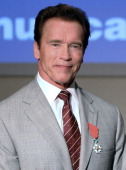 US actor and former California governor Arnold Schwarzenegger poses after being awarded as 'Officier de la Legion d'Honneur' during an award ceremony...