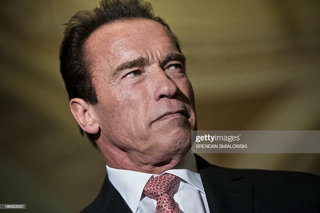 Actor and former California governor Arnold Schwarzenegger waits to speak to the press on Capitol Hill October 30 2013 in Washington DC Actor Arnold...