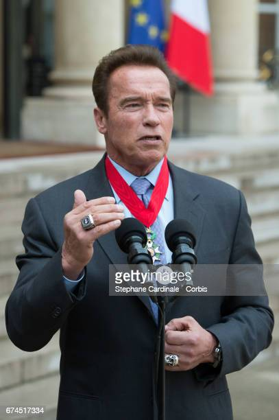 US actor and former governor of California Arnold Schwarzenegger delivers a speech after he was awarded France's highest national order the...