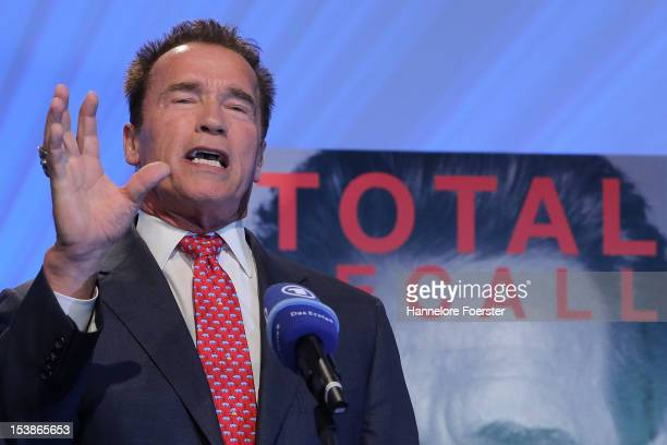 Actor and former Governor of California Arnold Schwarzenegger attends a news conference about his new biography entitled 'Total Recall My...