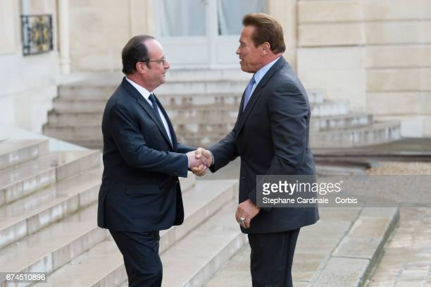 US actor and former governor of California Arnold Schwarzenegger is welcomed by French president Francois Hollande prior to a meeting at the Elysee...