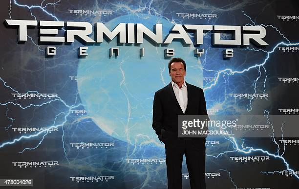 US actor and former governor of California Arnold Schwarzenegger poses for photographers upon arrival for the European premiere of the film...