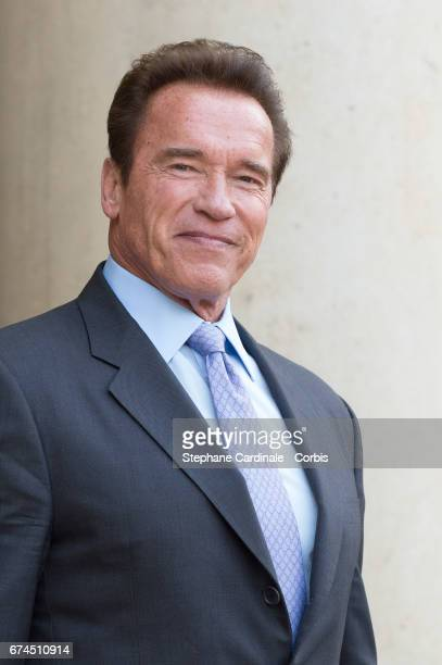 US actor and former governor of California Arnold Schwarzenegger poses prior to a meeting with French President Francois Hollande at the Elysee...